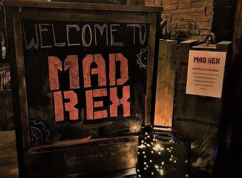 Mad Rex is unlike any other bar/restaurant that you have previously been to. Not one inch of the 8,500 square foot space, which seats 225 people was left untouched in the design process. Everything from ceiling to floor, inside and out, even down to the silverware was carefully selected to give patrons the full post-apocalyptic experience.