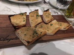 The garlic bread....ah the garlic bread. What can we say about the garlic bread other than, it was garlic bread. Perhaps our expectations were too high given our experience up to this point. I'm not sure if you can really reinvent the wheel when it comes to something as simple as this. However at a fine dining establishment such as this, maybe we expected something a bit more elevated? Don't get us wrong, the garlic bread was fine. But it was Italian bread, butter, garlic, and parsley. We did feel it should have been toasted a bit more (We took it home and warmed it up the next day in the oven, it was better crispy). The garlic bread was by no means bad, but we would recommend trying one of Symon's other offerings.