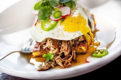 Paladar will be open seven days a week for lunch and dinner service. A weekend brunch also will be available on Saturdays and Sundays. Diners can expect to find dishes such as Adobo Wild Shrimp & Grits, Huevos Rancheros, Maple Pulled Pork & Fried Eggs, and Crispy Duck Confit & Fried Egg Hash.