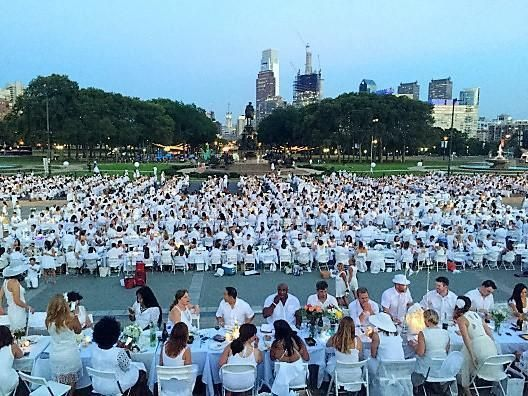 Originally started 30 years ago with just a handful of friends by François Pasquier nearly 30 years ago, Le Dîner en Blanc® de Paris now assembles over 10,000 guest every year, with a record 15,000 people attending the 25th anniversary in 2013. The French capital's most prestigious sites have played host the event over the years. Le Dîner en Blanc® began as a strictly word-of-mouth event. Today, it has grown to rely on the Internet and social media to communicate with its members and others who are curious about the event. Although the technology behind this fantastic event may have changed over the years, the principles fueling it have not; guests continue to gather at a secret location with the sole purpose of sharing a gourmet meal with good friends at the heart of one of their city's most beautiful locations.